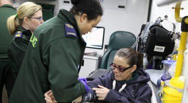 Photo of North West Ambulance Service paramedics attending a patient