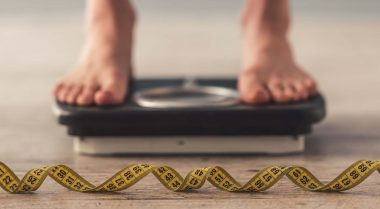 Person standing on weighing scales